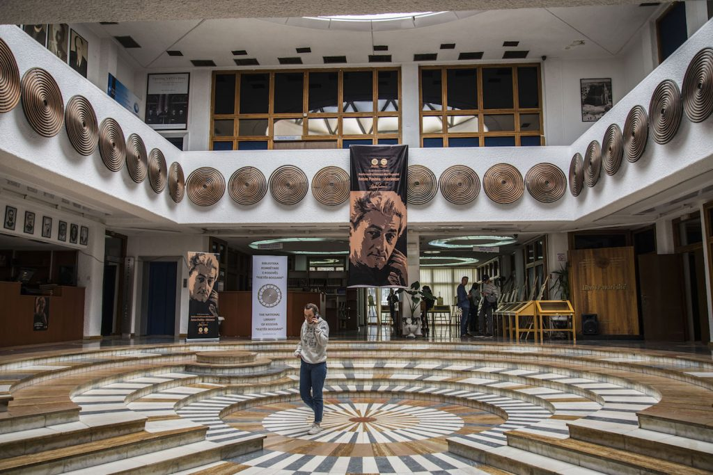 The library's principal interior feature is an atrium with a circular,  particolored, stepped floor decorated on the day of my visit to honor an  Albanian ...